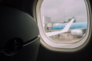 Plane on tarmac through plane window